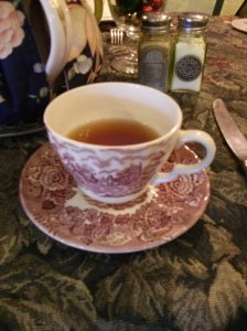 Picture taken at a quaint Victorian tea place my women colleagues go for holiday tea every December. Love the tea, but not the cup- I drink from large ceramic mugs!